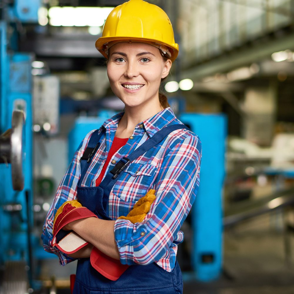 happy-young-woman-working-at-factory-DWN33CH.jpg